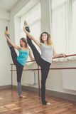 Two fit women are doing ballet exercise Royalty Free Stock Photos