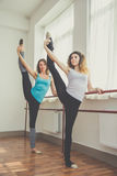 Two fit women are doing ballet exercise Stock Image