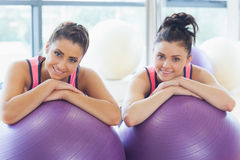 Two fit women with exercise balls at gym Stock Photo