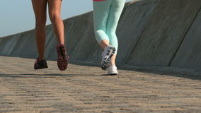 Two fit women running together stock footage