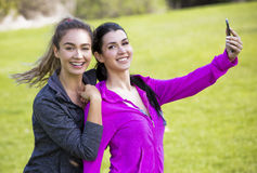 Two fit women taking selfie together Stock Photos