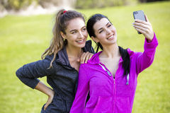 Two fit women taking selfie together Stock Image