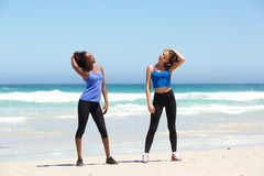 Two fit young women enjoying workout at the beach Stock Photography
