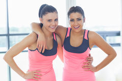 Two fit young women smiling in a bright exercise room Stock Images
