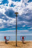Two fitness equipment at beach Stock Photos