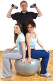Two fitness girls and man Stock Photo