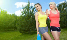 Two fitness girls outdoor Stock Photos