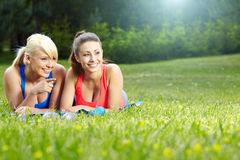 Two  fitness girls outdoor Royalty Free Stock Image