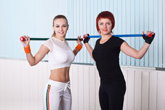Two fitness women doing exercises Royalty Free Stock Photos