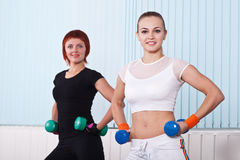 Two fitness women with hand weights Royalty Free Stock Images