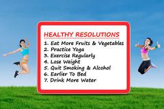 Two fitness women and healthy resolutions Royalty Free Stock Photography