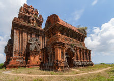 Two of the five Banh It Cham towers on the hill. Stock Photo