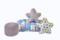 Two five-pointed star shaped pillows, patchwork comforter and knitted padded stool on white background. Two five-pointed star shaped pillows, patchwork Royalty Free Stock Photo
