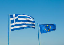 Two flags are developed in the wind, Greece Royalty Free Stock Photography