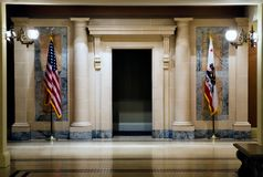 Two flags in hallway Royalty Free Stock Images