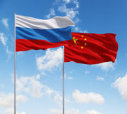 Two flags of Russia  and China. Two flags of Russia and China on a sky background Royalty Free Stock Image