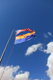 Two flags on a strong wind Royalty Free Stock Photos