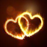 Two flame hearts on the dark Royalty Free Stock Images