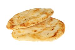 Two naan breads. Two flamebaked naan breads isolated against white Royalty Free Stock Images