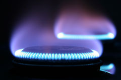 Two flames. Flames of gas on stove Stock Photos