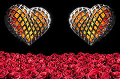 Two flaming heart in a cage Stock Photos