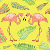 Two flamingos with beaks together with tropical leaves around. Seamless pattern. Vector illustration on yellow background. Hand drawn two flamingos with tropical vector illustration
