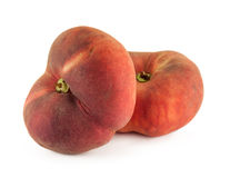 Two flat donut peaches isolated on a white background Stock Photos
