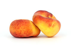 Two Flat Golden Peaches Royalty Free Stock Photo