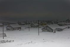 Between two flaws of blizzard. Dark winter storm (Nikol'skoje village, Commander Islands Royalty Free Stock Photography