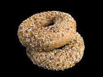 Two Flaxseed Bagels. Isolated on Black royalty free stock photography