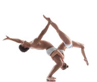 Two flexible acrobats posing in studio Stock Photography