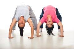 Two flexible women doing back-bend royalty free stock photo