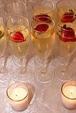 Champagne, Strawberries and Candles in Rows Royalty Free Stock Image