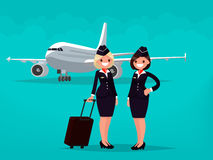 Two flight attendants against the backdrop of civil aircraft.  Royalty Free Stock Photography