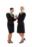 Two flight attendants with a model airplane stock images