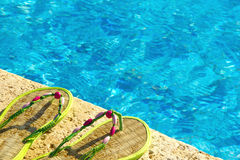 Two flip flops near swimming pool Stock Image