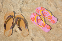 Two flip flops on a sandy ocean beach Stock Image