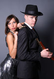 Two flirting gangsters. Standing in studio Stock Image