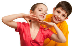 Two flirting kids. Two smiling children isolated on the white background Royalty Free Stock Image
