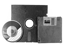 Two floppy disks and CD-ROM Royalty Free Stock Photos