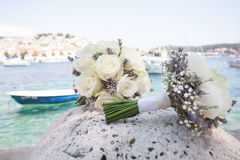 Two flower bouquets and a boat Stock Photo