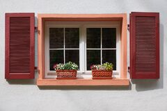 Free Two Flower Pots On The Old Window With Wooden Shutters On White Wall Royalty Free Stock Image - 169304636