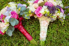 Two flowers bouquet. Two natural wedding bouquet photographed on grass outside Stock Image