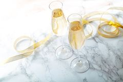 Two flute glasses with champagne stock photo