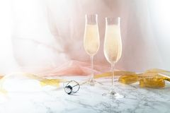 Two flute glasses with champagne on marble background Royalty Free Stock Image