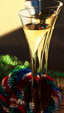 Two flutes of Champagne, Christmas wreath and spruce branch Royalty Free Stock Image