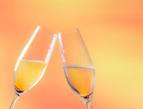 Two flutes of champagne with golden bubbles and space for text Stock Photography