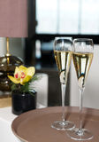 Two flutes of champagne on restaurant table Stock Photo