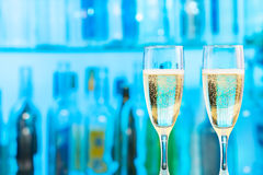 Two flutes with champagne standing at bar counter Royalty Free Stock Photos