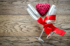 Two flutes with retro cane heart on the wooden background Stock Photography